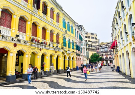MACAU-MAY 9 : Tourists visit the Historic Centre of Macao-Senado Square on May 9, 2013 in Macau, China. The Historic Centre of Macao was inscribed on the UNESCO World Heritage List in 2005.