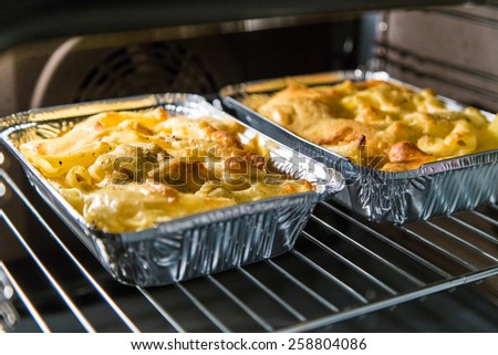 maccheroni with cheese in oven - stock photo