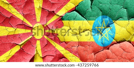 Macedonia flag with Ethiopia flag on a grunge cracked wall - stock photo