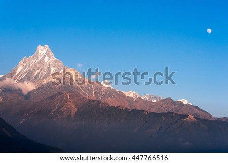 Machapuchare or Fishtail peak mountain with blue sky. it is a mountain in the Annapurna Himal of north central Nepal. - stock photo