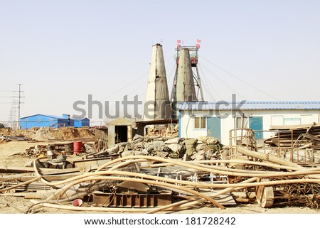 MACHENG - March 13: Intricately stacked with all kinds of materials in MaCheng iron mine, on march 13, 2014, Luannan County, Hebei Province, China  - stock photo