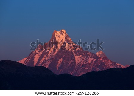 Machhapuchchhre mountain - Fish Tail in English is a mountain in the Annapurna Himalya, Nepal - stock photo