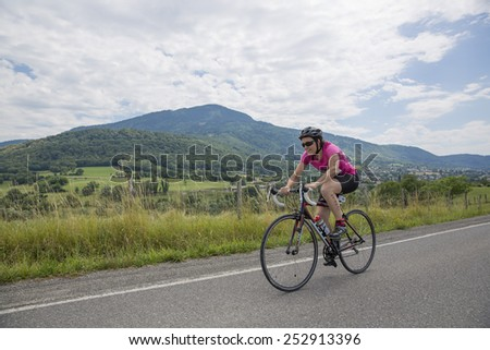 MACHILLY, FRANCE JULY 6, 2014: Unidentified athlete participates in the cycling race of the Lake Machilly Triathlon which is part of the TriSaleve of Annemasse organization. - stock photo