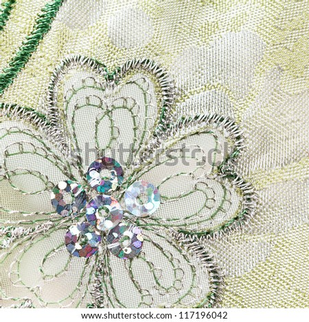Machine embroidered flower with metallic thread and sequins - stock photo