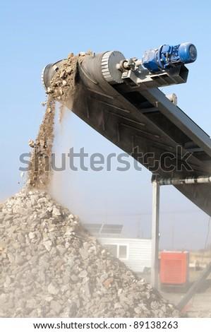 Machine for crushing stone. Falling rocks - stock photo