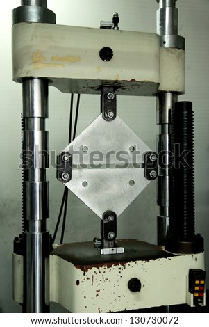 Machine for metal tension test - stock photo