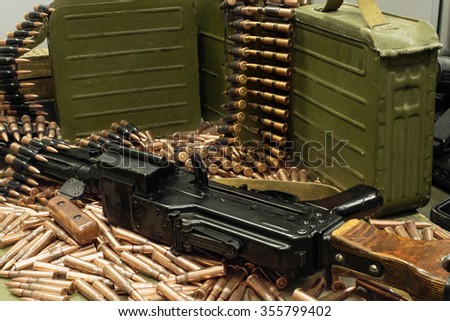 machine gun and boxes of ammunition  - stock photo