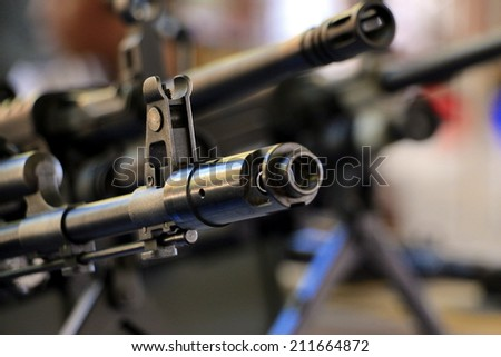 Machine gun front sight and muzzle - stock photo