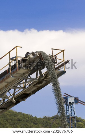 Machine pouring stones , Stone truck - stock photo