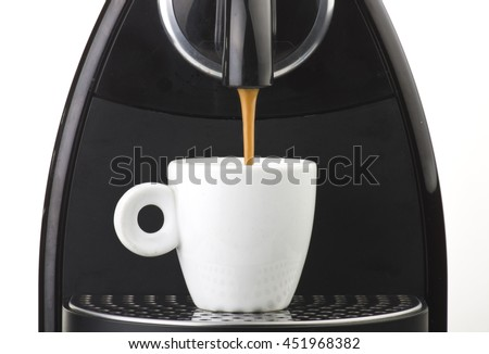 machine serving espresso coffee in a glass cup  - stock photo