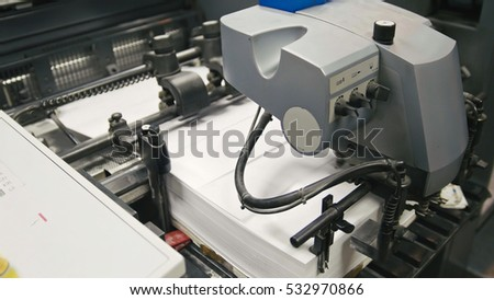 Machine working in printing house, polygraph industry - cleaning equipment, front view