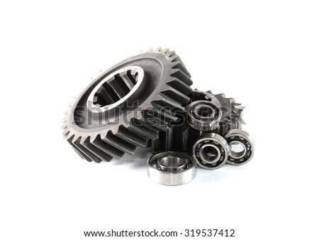 Machinery concept. Old rusty gears and ball bearing on white background
