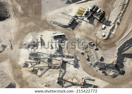 Machinery crushing gravel in a gravel pit - stock photo