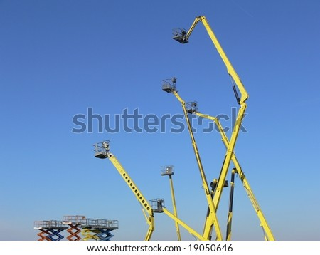 Machinery on the blue sky background - stock photo