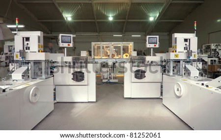Machines for making handkerchiefs, rolls and serviettes. - stock photo