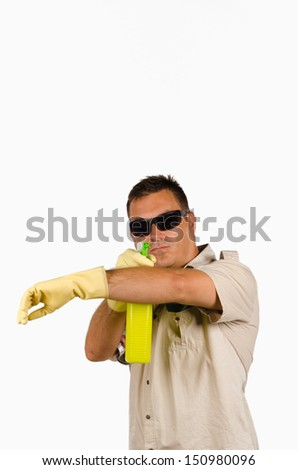 Macho type of guy with cleaning product - stock photo