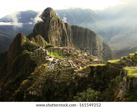 Machu Picchu Inca Lost city in mist - stock photo