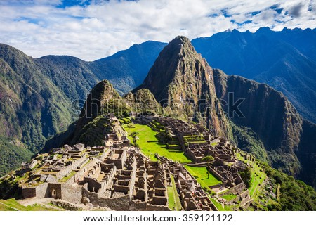 Machu Picchu is a UNESCO World Heritage Site in Peru since 1983. Machu Picchu is a one of the New Seven Wonders of the World in Peru. - stock photo