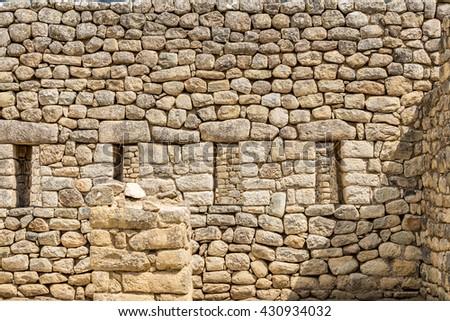 Machu Picchu rock wall, Cusco, Peru, South America. A UNESCO World Heritage Site - stock photo