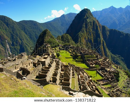 Machu Picchu - the UNESCO heritage in summer time with blue sky - stock photo