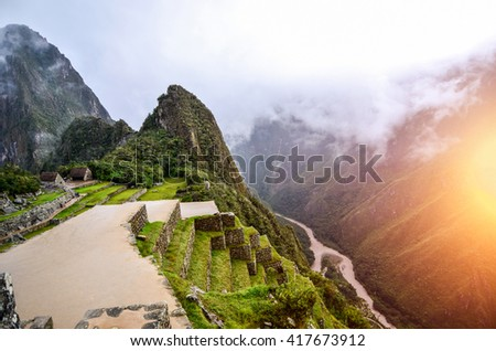 Machu Picchu - the UNESCO heritage in summer time with sunset. - stock photo