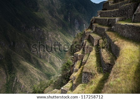 Machu pichu, Peru, view of the Andes, agricultural terraces created by the Incas. - stock photo