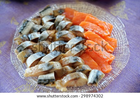 mackerel and red fish, salmon, on the dining table in a dish on