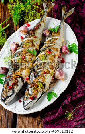 Mackerel baked with red currants, grain mustard and rice - stock photo