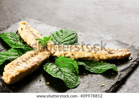 mackerel fillet with aromatic herbs and spices over slate