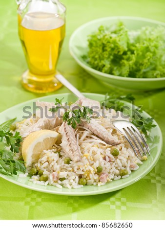 mackerel fillet with rice salad over green table