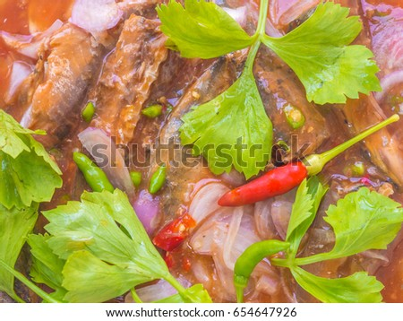 Mackerel fish in tomato sauce and cook in Thai spicy salad.