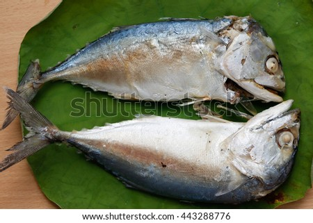 Mackerel steamed on a banana leaf.