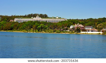Mackinac Island's Grand Hotel and other buildings seen from off shore - stock photo