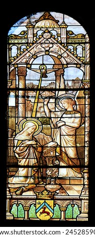 MACON, FRANCE - January 13, 2015: Colourful seamless stained glass window panel  in the Cathedral of Macon, Borgogne, France - stock photo