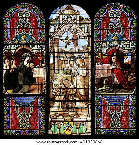 Macon, France - January 13, 2015: Stained glass window illustrated Bible stories in the Cathedral of Macon, Borgogne, France