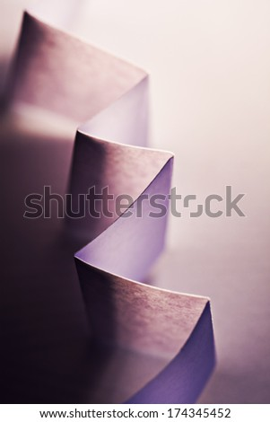 Macro, abstract, background picture of a  orange zig-zag paper on paper background