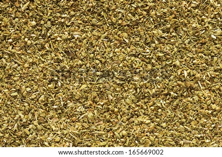 macro background image of dried oregano flakes herb - stock photo