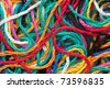 macro background of multi-colored needlecraft embroidery threads - stock photo
