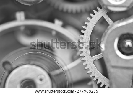 Macro, Black white background with metal cogwheels a clockwork. Conceptual photo for your successful business design - stock photo