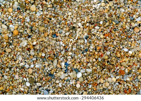 Macro close up image of small smooth pebbles with Cape May diamonds mixed in on a beach in Cape May - stock photo