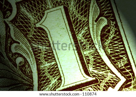 Macro close-up of a one dollar bill with dramatic lighting - stock photo