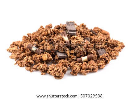Macro close up of chocolate muesli with pieces of chocolate