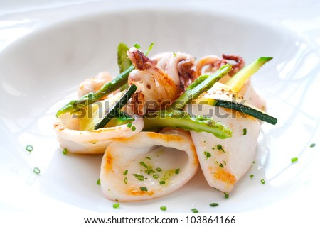 Macro Close up of grilled calamari and green asparagus. - stock photo