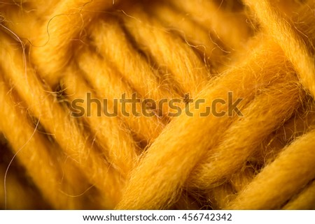 Macro Close up of Wool Yarn Treads in Mustard Yellow Color  - stock photo