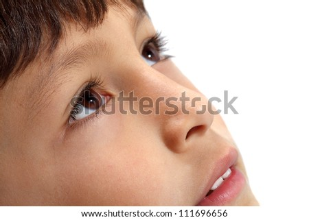 Macro close-up of young boy's eyes looking up on white background