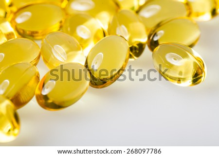 Macro Close-up Transparent Vitamins On a White Table - stock photo