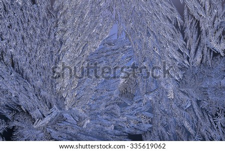Macro, closeup of a frosty, icy glass window. Beautiful texture, pattern on a winter window after a cold night. Crystals all over. Blue. - stock photo