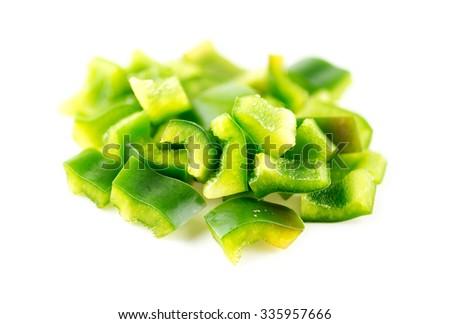 Macro closeup of diced green capsicum - stock photo