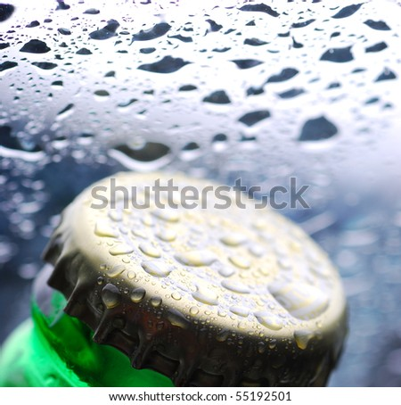Macro closeup of waterdrops on beer - stock photo