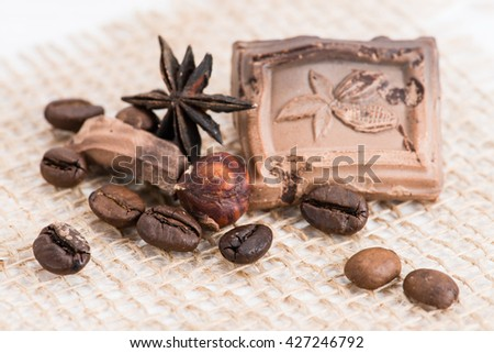 macro coffee beans, hazelnuts and old chocolate - stock photo